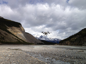 Drone flying over river bed
